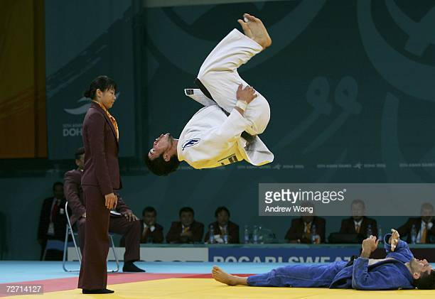 Tsagaanbaatar Haskhbaatar of Mongolia celebrates with a somersault after winning the gold medal by defeating Arash Miresmaeili of the Islamic...