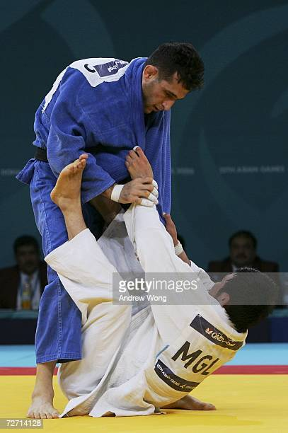 Tsagaanbaatar Haskhbaatar of Mongolia tussles with Arash Miresmaeili of the Islamic Republic of Iran during the Men's Judo 66kg final during the 15th...
