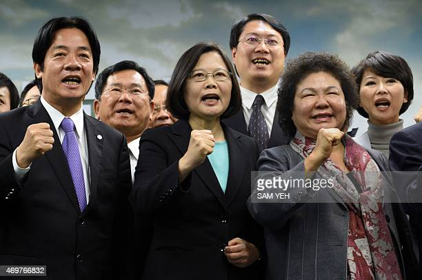 Tsai Ingwen chairwoman of Taiwan's main opposition Democratic Progressive Party gestures with party members during a press conference in Taipei on...