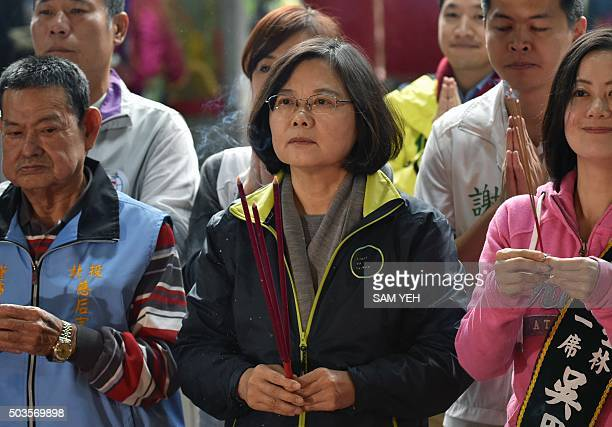 Tsai Ingwen presidential candidate for Taiwan's main opposition Democratic Progressive Party holds an incense while praying at a local temple during...