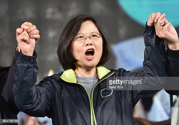 Tsai Ingwen presidential candidate for Taiwan's main opposition Democratic Progressive Party joins hands with supporters during a rally in southern...