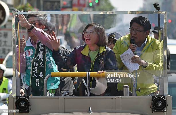 Tsai Ingwen presidential candidate for Taiwan's main opposition Democratic Progressive Party waves to supporters during an election campaign in...