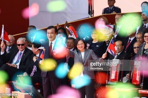 Tsai Ingwen Taiwan's President front row center and Su Chiachyuan president of the Legislative Yuan front row center left wave flags during National...