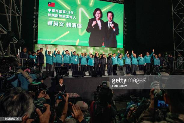 Tsai IngWen waves after addressing supporters following her reelection as President of Taiwan on January 11 2020 in Taipei Taiwan Tsai IngWen of the...