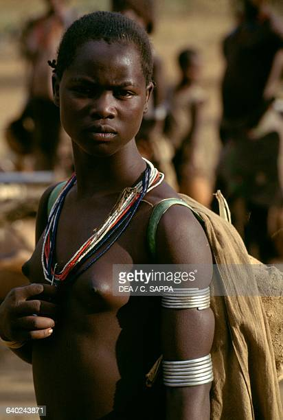 Tsamai girl wearing traditional decorations Key Afer Ethiopia