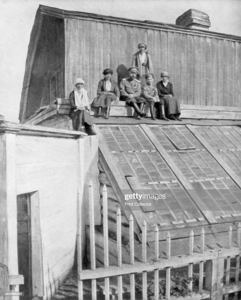 Tsar Nicholas II and his children sitting on a greenhouse, Tobolsk, Siberia, Russia, 1917. : News Photo