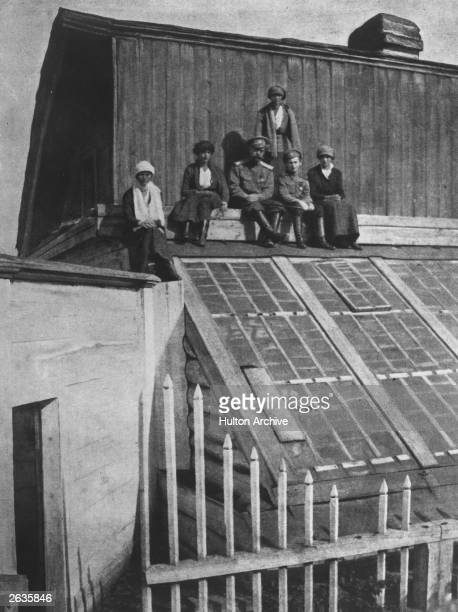 Tsar Nicholas II and his children sitting on the roof of a conservatory during their captivity in Tobolsk from September 1917 to April 1918 From left...