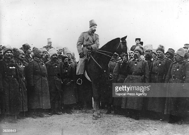 Tsar Nicholas II in Cossack uniform inspecting Cossacks