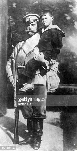 Tsar Nicholas II of Russia Emperor 18941917 with his son Alexei in the 1910s Photo M Koch