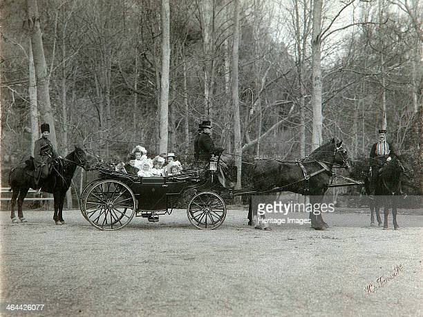 Tsar Nicholas II of Russia with his family in the park of Tsarskoye Selo Russia early 1900s Nicholas with his mother the Empress Maria Fyodorovna and...