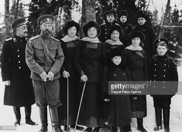 Tsar Nicholas II of Russia with members of his family in the private grounds of Tsarskoe Selo the summer palace From left to right an officer...
