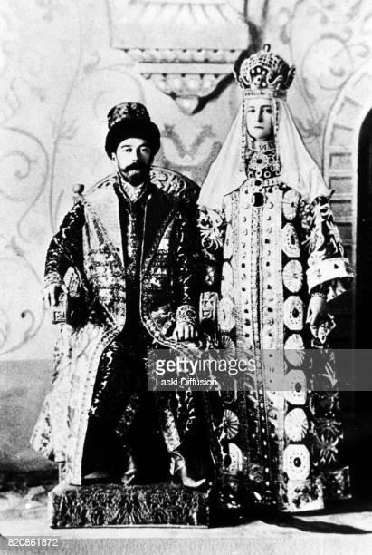 Tsar Nicholas II Romanov and Empress Alexandra Feodorovna Romanova in historical costumes. Russia, 1903.