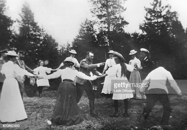 Circa 1915: Tsar Nicholas II Romanov of Russia with family. Russia.