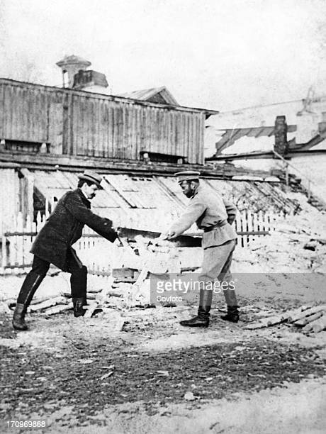Tsar nicholas ll cutting wood with pierre gilliard the tutor of tsarevich alexei during their imprisonment in tobolsk in 1918