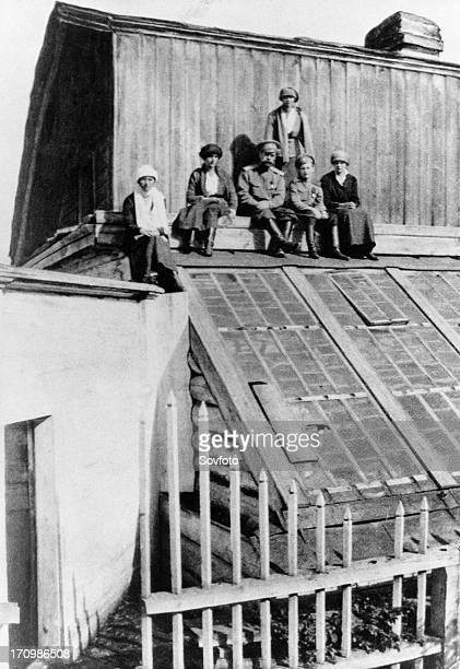tsar nicholas ll with his family on the roof of the house in tobolsk where they were held in 1918 before being transferred to yekaterinberg to be shot