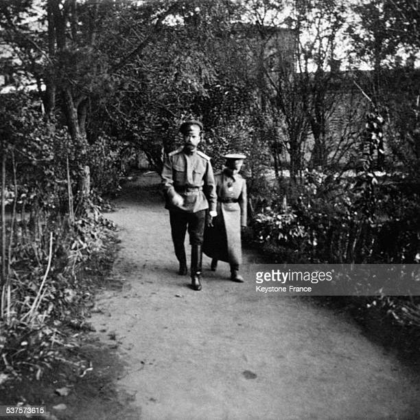 Tsar Nicolas II and Tsarevich Alexis Nikolaevich walking in an alley circa 1910 in Russia