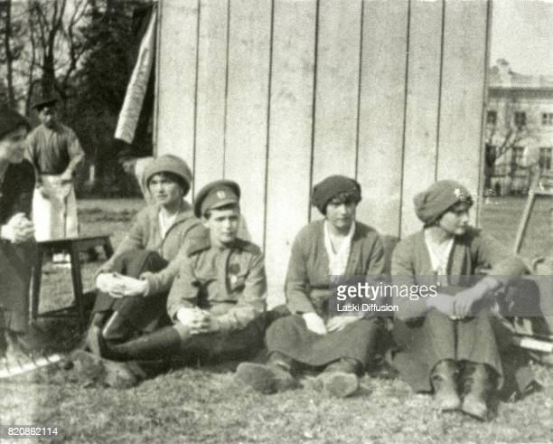 Tsarevich Alexei Romanov and three Grand Duchesses of Russia after the abdication of their father Tsar Nicholas II Romanov Tsarskoye Selo Russia...