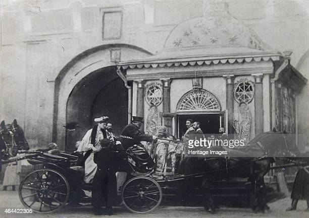 Tsarina Alexandra Fyodorovna visiting the Iberian Chapel Moscow Russia 1900s The chapel stands in front of the Iberian Gate the entrance to the...