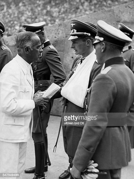 Tschammer und Osten Hans von Reichssportfuehrer Germany*25101887 Olympic Games 1936 in Berlin in conversation with mit Konrad Baron of Wangenheim he...