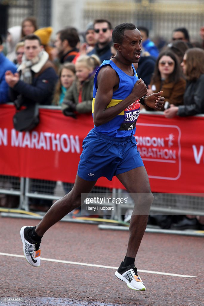 Tsegai Tewelde of Eritrea passes Buckingham Palace during the Virgin Money London Marathon on April 24, 2016 in London, England.