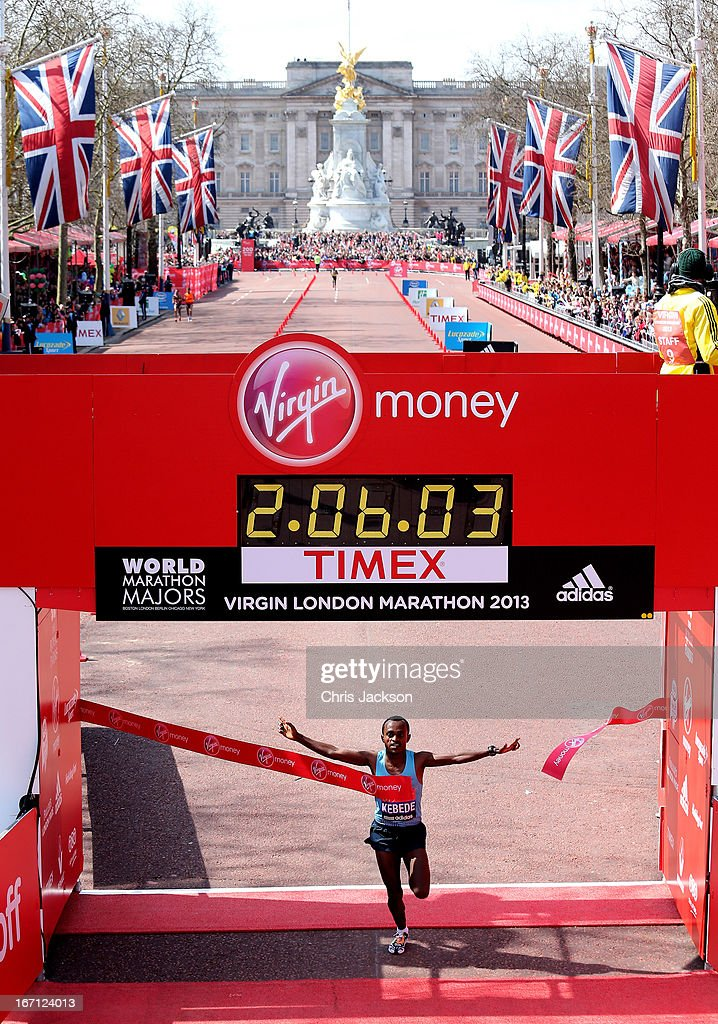 Tsegaye Kebede of Ethiopia crosses the finish line to win the Mens Elite section during the Virgin London Marathon 2013 on April 21, 2013 in London, England.