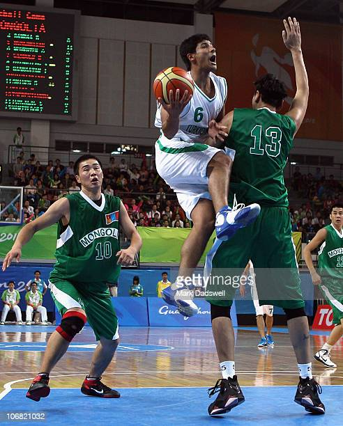 Tserenjankhar of Mongolia blocks Toyli Bayriyev of Turkmenistan in the Men's Basketball Qualifying Roung Group C Game 3 match between Mongolia and...