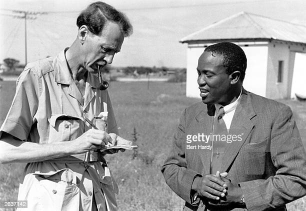 Tshekedi Khama, , right, chief regent of the Bamangwato from 1925, chief of Bechuanaland and uncle of Seretse Khama, talking to journalist Fyfe...