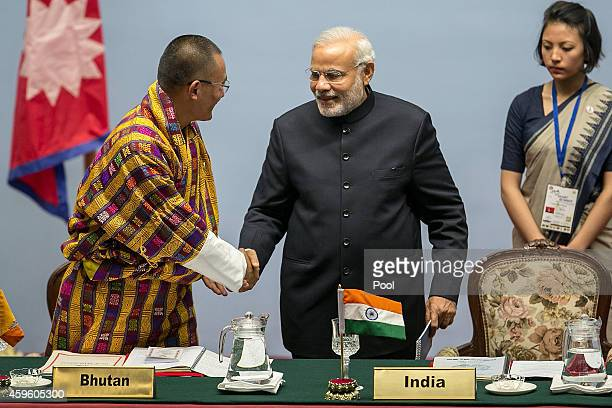 Tshering Tobgay Prime Minister of Bhutan greets Narendra Modi Prime Minister of India during the inaugural session of the 18th SAARC Summit on...