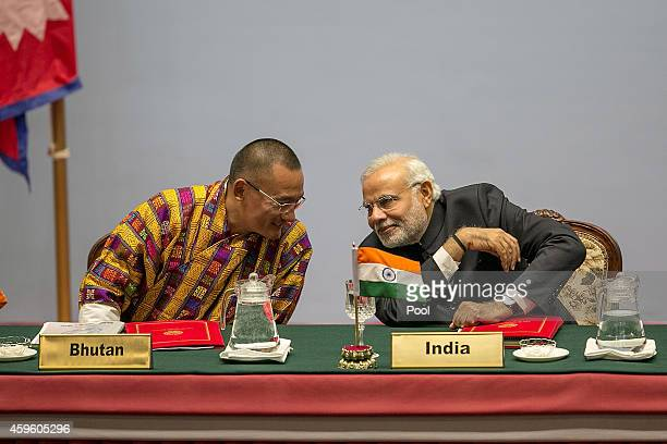 Tshering Tobgay Prime Minister of Bhutan speaks to Narendra Modi Prime Minister of India during the inaugural session of the 18th SAARC Summit on...