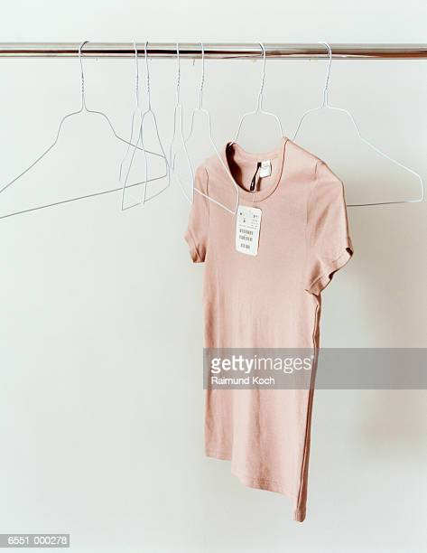T-shirt and Hangers on Rail