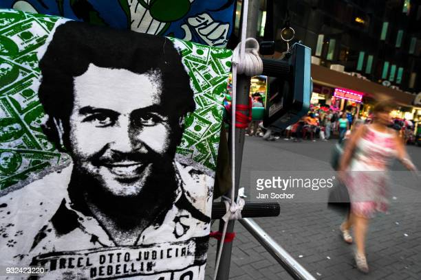 A tshirt for sale depicting the drug lord Pablo Escobar is seen arranged at the market stand on the street in Medellín Colombia on November 29 2017...