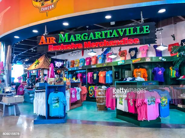 t-shirt shop in cancun international airport, mexico - gift shop stock pictures, royalty-free photos & images
