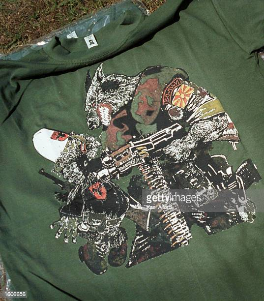 A tshirt sporting a cartoon of a wolf dressed as a member of the Macedonian special forces unit Wolves holding a gun to an Albanian rebel is among...