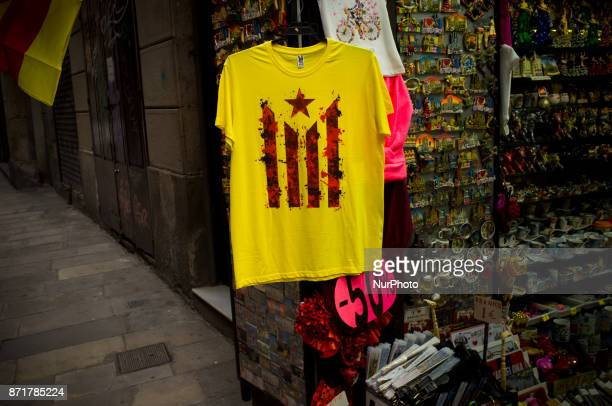 A tshirt with the estelada or proindependence sign hangs in a souvenirs shop in Barcelona downtown Spain on 8 November 2017 Catalonian territory went...