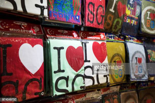 Tshirts are displayed for sale at a stall in the Chinatown area of Singapore on Wednesday June 13 2018 Tourism as well as the consumer sector will...
