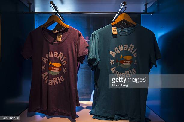 Tshirts are displayed for sale inside the gift shop at AquaRio South America's largest aquarium in Rio de Janeiro Brazil on Saturday Dec 3 2016...