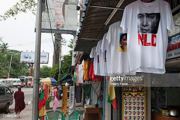Tshirts bearing portraits of Aung San Suu Kyi and the logo of her party the National League for Democracy are sold on a Yangon street