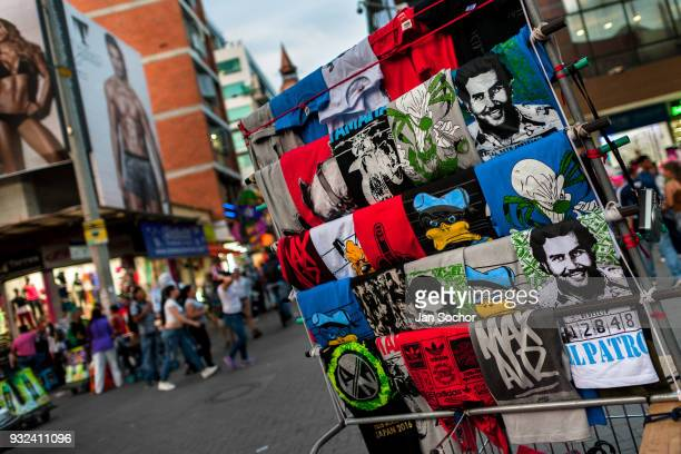 Tshirts for sale depicting the drug lord Pablo Escobar are seen arranged at the market stand on the street in Medellín Colombia on November 29 2017...