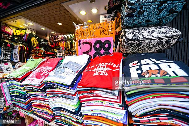 t-shirts for sale in gift shop, san francisco - gift shop stock pictures, royalty-free photos & images