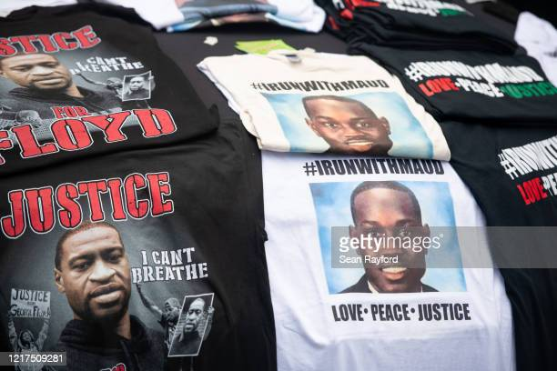 Tshirts memorializing George Floyd and Ahmaud Arbery are displayed for sale on a car hood outside the Glynn County courthouse during a court...