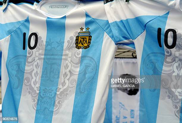 Tshirts of soccer star Lionel Messi and former player and coach of Argentina Diego Maradona are displayed on Setember 3 2009 near the stadium where...