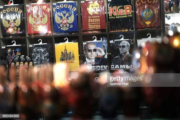Tshirts with a picture of Russian President Vladimir Putin are displayed in a Moscow shop on March 9 2017 in Moscow Russia Relations between the...