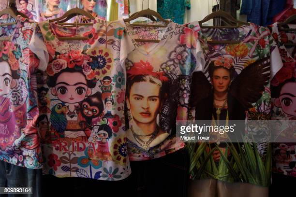 Tshirts with the image of the Mexican artist Frida Kahlo are seen during the Frida Kahlo's 110th birthday anniversary at the Coyoacan's market on...
