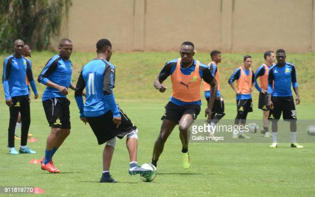 TSibusiso Vilakazi and Usain Bolt during the Usain Bolt Visit to Mamelodi Sundowns Training Session at Chloorkop on January 29, 2018 in Pretoria,...