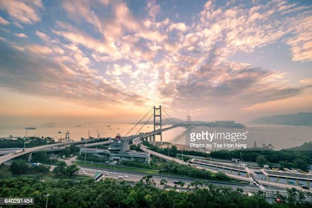 Tsing Ma Bridge, the Hong Kong landmark, at sunset with dramatic sky