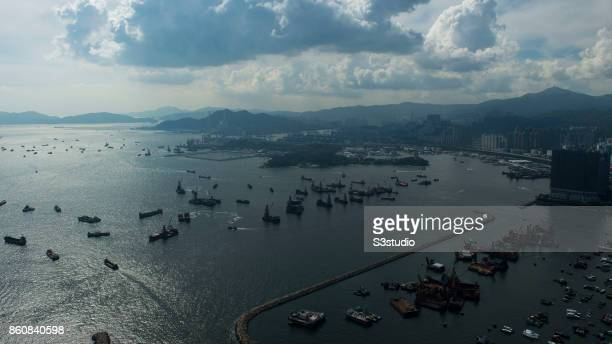 Tsing Yi district with Tsing Ma Bridge Stonecutters Island are seen with New Yau Ma Tei Typhoon Shelter by the Victoria Harbour on 16 July 2014 in...