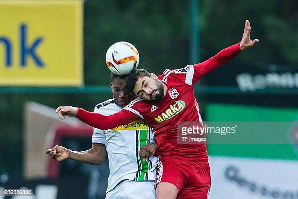 Tsiy William Ndenge of Moenchengladbach and Dani Abalo of Sivasspor battle for the ball during the Friendly Match between Borussia Moenchengladbach...