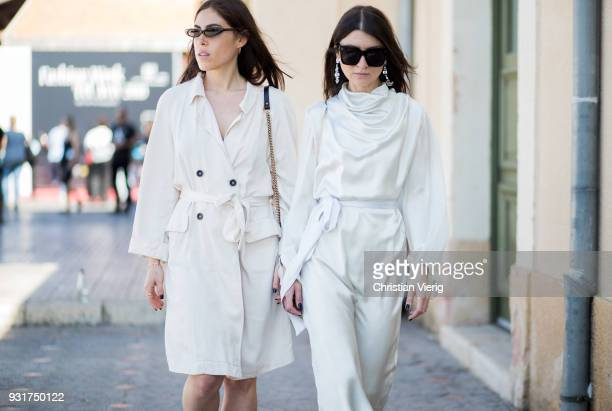 Tslil Kotser and Shiran Mania wearing creme white dress is seen during Tel Aviv Fashion Week on March 13 2018 in Tel Aviv Israel