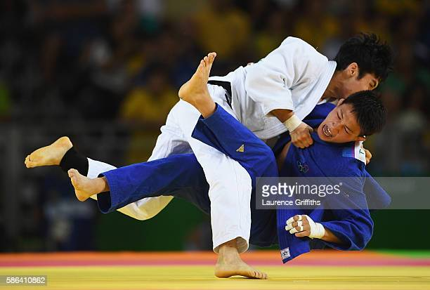 Tsogtbaatar TsendOchir of Mongolia gets taken down by Won Jin Kim of Republic of Korea in the Men's 60 kg Judo on Day 1 of the Rio 2016 Olympic Games...