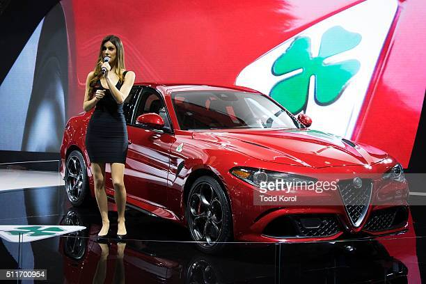 Tstar 2016 auto show An Alfa Romeo hostess highlights some of the new features on the 2017 Alfa Romeo Giulia at the Canadian International Autoshow...